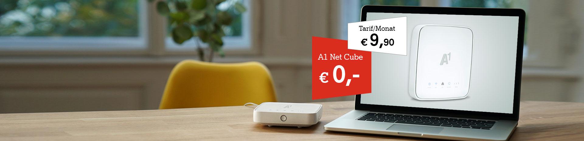 A1 Net Cube neben einem Laptop auf einem Schreibtisch