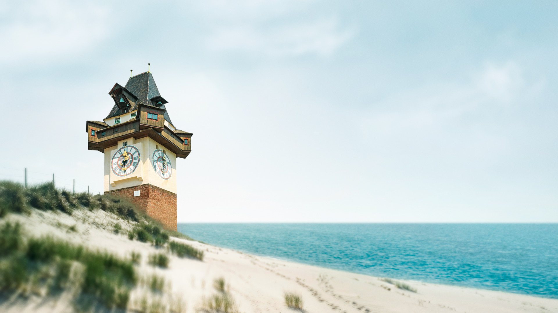 Grazer Uhrturm am Strand